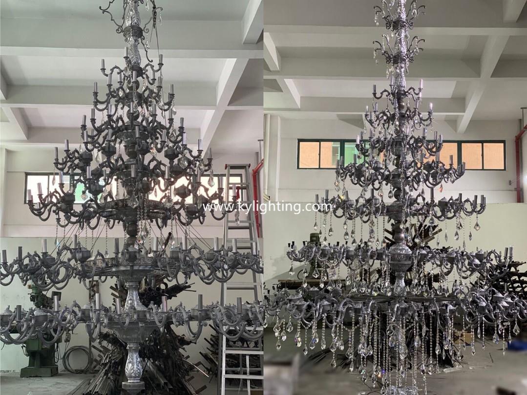 trial installation of custom chandelier